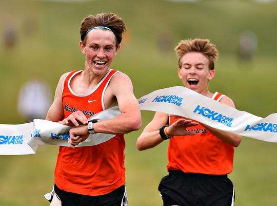 Northeastern's Cole Perry, left, and James Herman race neck and neck to the finish line during cross country action at Northeastern Senior High School in Manchester, Thursday, Sept. 5, 2019. Perry would place first at 17:09.79 and Herman second at 17:10. Dawn J. Sagert photo