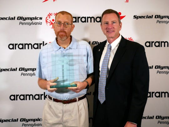 Longtime York County Special Olympics athlete Corey Markle (left) was inducted into the Pennsylvania Special Olympics Hall of Fame in August.