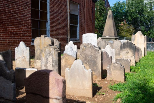 Rows of headstones stand on the south side of the former Zion Lutheran Church in York. The graves were relocated as part of the Yorktowne Hotel renovation project.