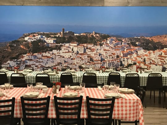 An image of a Spanish hillside town commands the elevated section of the dining room in the Santa Fe Hotel Basque restaurant in downtown Reno.