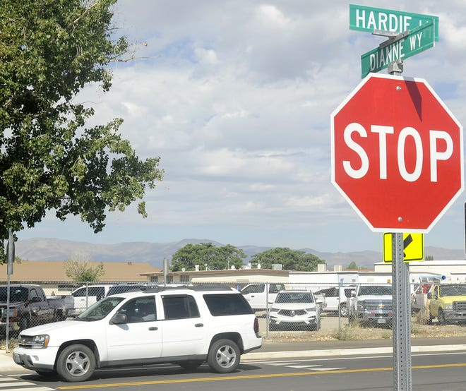 An SUV drives on the recently-paved Hardie Lane, the latest major road project cash-strapped Fernley has been able to complete. The city is asking county commissioners to increase commercial development fees to help fund road repairs.