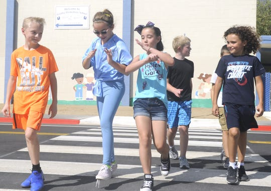 Fernley students walk across a crosswalk on Hardie Lane.