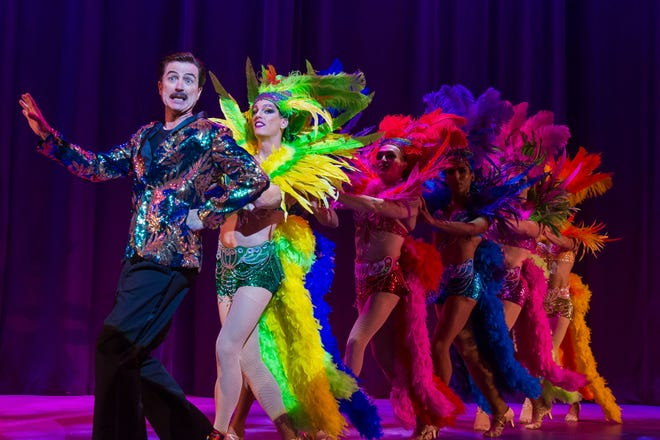 """Mark Cuddy as Georges with the Cagelles in Geva Theatre Center's production of """"La Cage aux Folles."""""""
