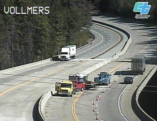 A red pickup towing an RV trailer crashed in one lane of southbound Interstate 5 on Thursday afternoon.
