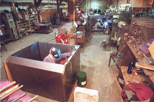 Workers weld inside the original Traeger Grills factory in Mt. Angel in 1999.