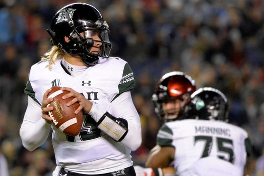 Nov 24, 2018; San Diego, CA, USA; Hawaii Warriors quarterback Cole McDonald (13) looks to pass during the first quarter against the San Diego State Aztecs at SDCCU Stadium. Mandatory Credit: Jake Roth-USA TODAY Sports