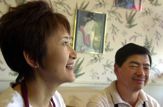 Kazuko and Haruo Ogawa, owners of Ramen Ichiban in south Salem, pictured in the restaurant in 2002.