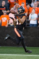 Aug 30, 2019; Corvallis, OR, USA; Oregon State Beavers wide receiver Isaiah Hodgins (17) catches a touchdown pass during the first half against the Oklahoma State Cowboys at Reser Stadium. Mandatory Credit: Troy Wayrynen-USA TODAY Sports