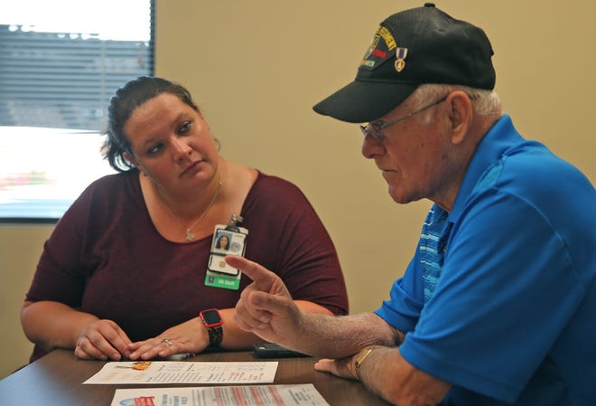 Veterans Affairs dietitian Ansleigh Swartwood, left, talks to Randy Bannert during a cooking class at the San Angelo VA clinic Tuesday, August 27, 2019.