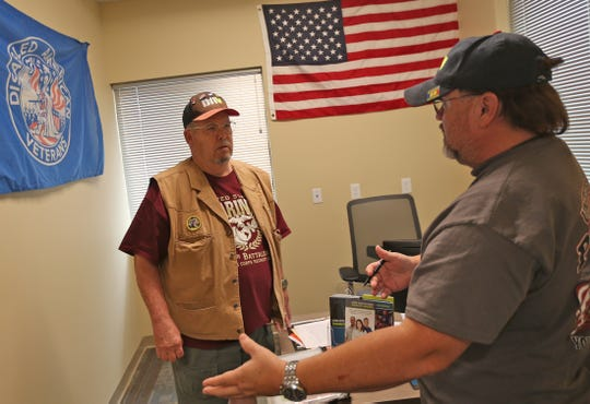 Volunteers Michael Rader, left, and Troy Crosby, right, work in the Disabled American Veterans office where they help people navigate the new San Angelo VA clinic Tuesday, August 27, 2019.
