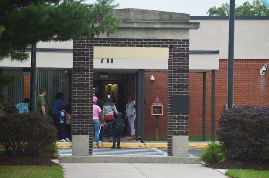 Students and parents arrive at Charles H. Chipman Elementary School in Salisbury, Maryland on Thursday, Sept. 5, 2019.