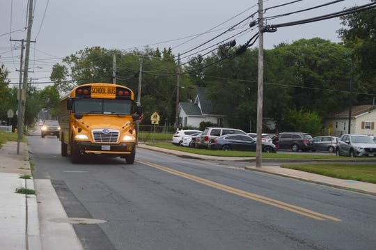 A school bus approaches the Lake Street crosswalk in front Charles H. Chipman Elementary School in Salisbury, Maryland on Thursday, Sept. 5, 2019.