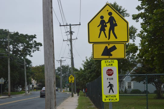Signage directs drivers to stop for pedestrians at the Lake Street crosswalk in front of Charles H. Chipman Elementary School in Salisbury, Maryland on Thursday, Sept. 5, 2019.