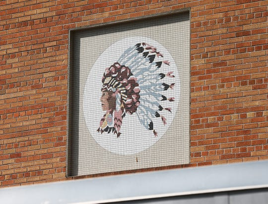 The Sheboygan South Redman mascot still can be seen on the outside wall of the auditorium area at the school, Thursday, September 5, 2019, in Sheboygan, Wis. The school went from the Redmen to the Redwings in the early 1990s.