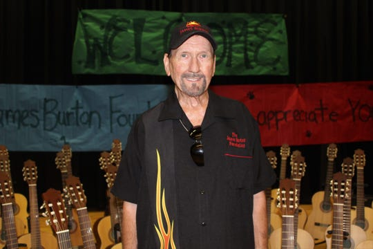 James Burton presents 60 acoustic guitars on behalf of The James Burton Foundation to North Caddo Elementary Middle School in Vivian.