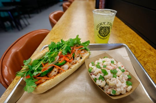 The blackened shrimp banh mi sandwich topped with sambal aioli with a Hawaii-style mac salad and an orange hibiscus Stubborn Soda at the Lucky Tiger Sandwich Co., which is located at 3654 S. Campbell Ave., in Springfield, Mo.