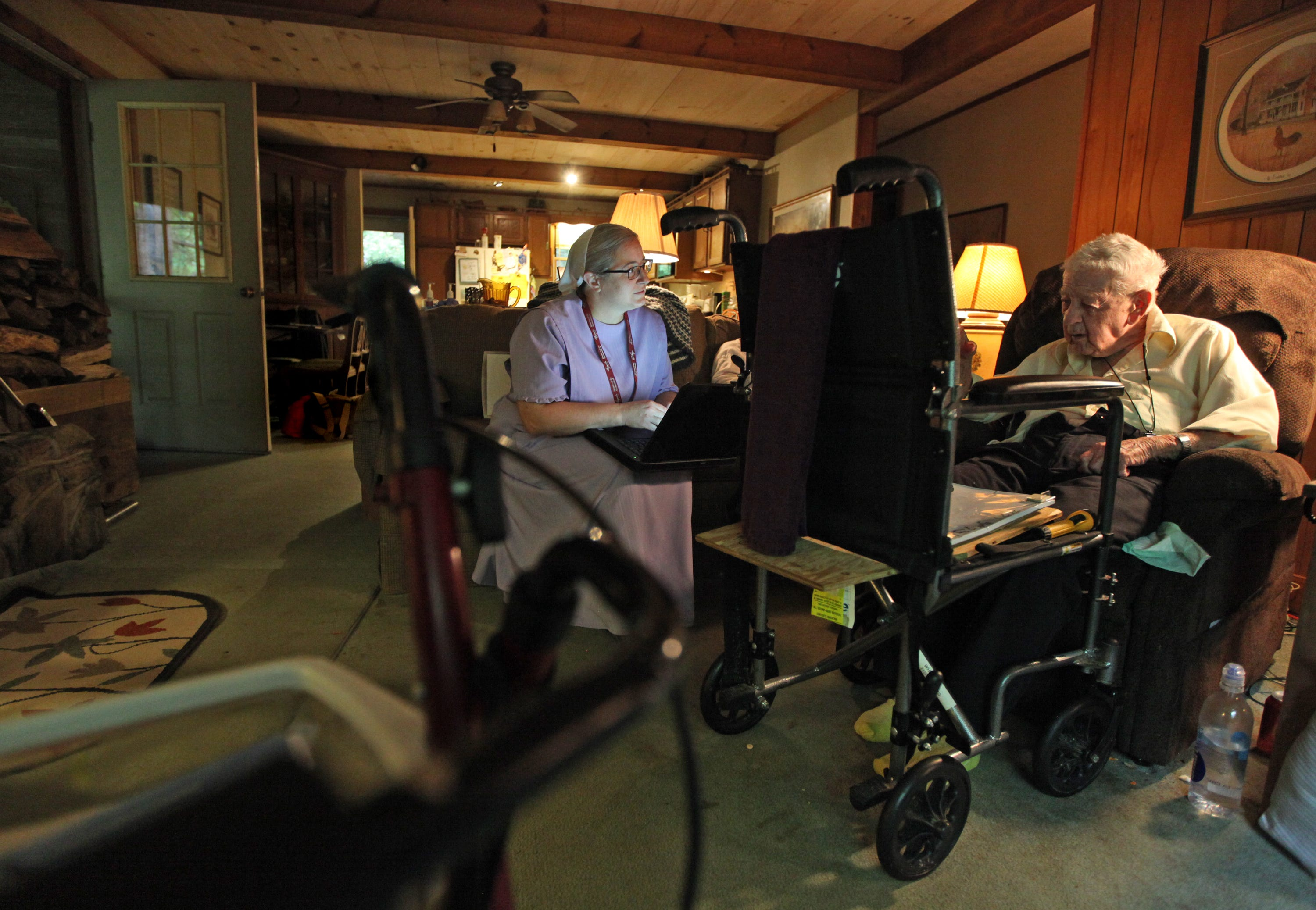 Laura Summy, a hospice nurse with Augusta Health, checks in on Raymond Wilkerson at his home in Swoope on Aug. 27, 2019. Wilkerson and his wife Jean are both receiving hospice care. Some of Summy's duties include monitoring heart rate and blood pressure, refilling prescriptions and answering any questions patients may have.