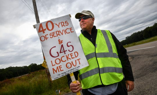 Security lieutenant Randy Sand holds a sign outside an entrance to the Monticello nuclear power plant Thursday, Sept 5, 2019. Sand and more than 20 other members of United Security Professionals Local 2 have been locked out of the plant since midnight Saturday.