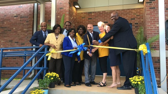 """Officials gather to cut the ribbon Thursday morning on new  """"Building 23"""" at Rickards High School."""