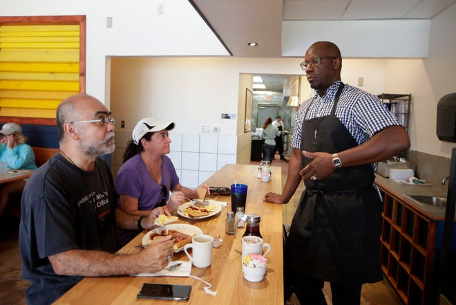 Tom DiTanna, left, and Terry DiTanna talk with Michael Robinson, co-owner of Ma's Diner about their menu and the first day of the restaurant being open for business Thursday, Sept. 5, 2019.