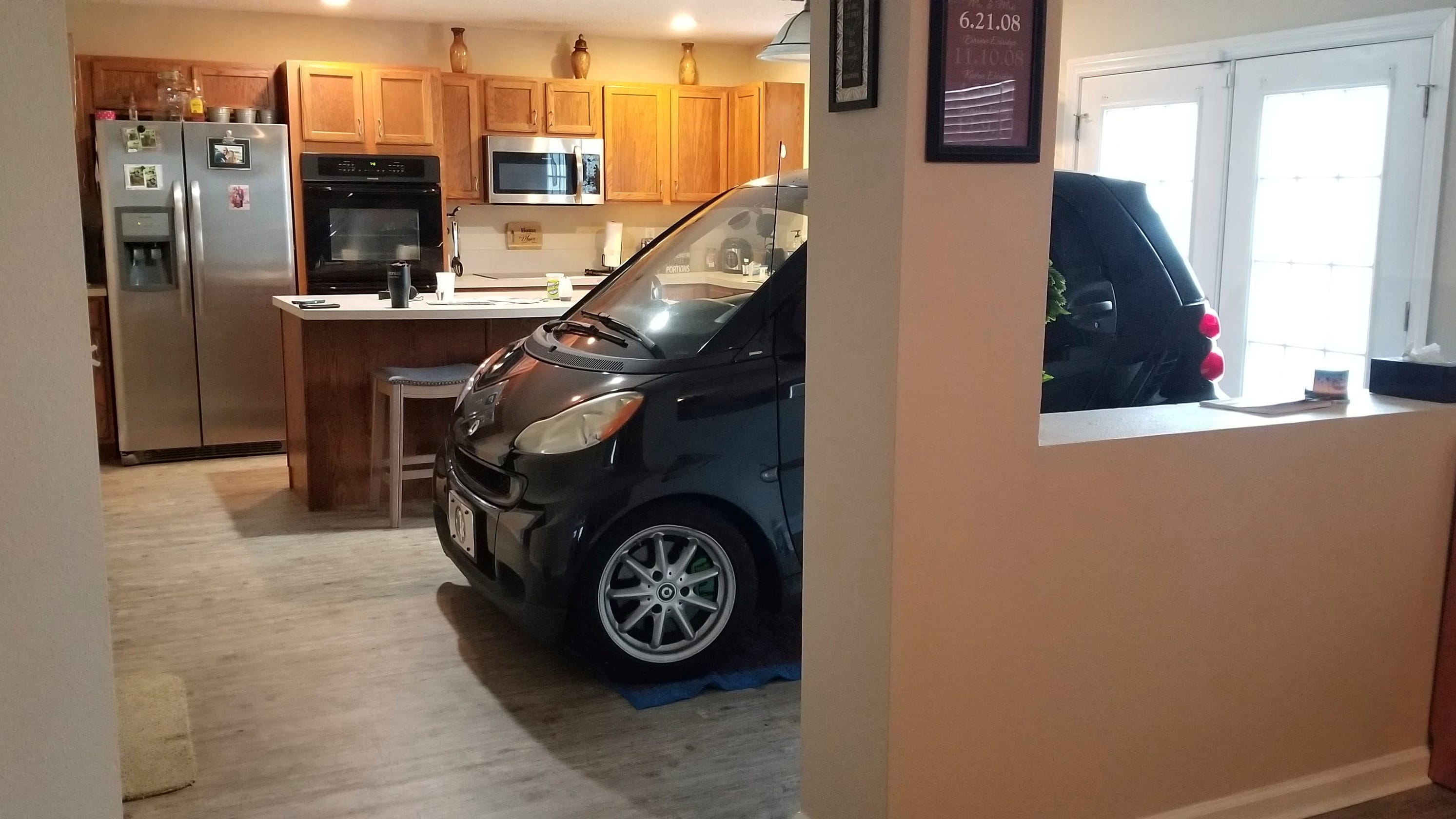 Florida State fan parks Smart car in kitchen before