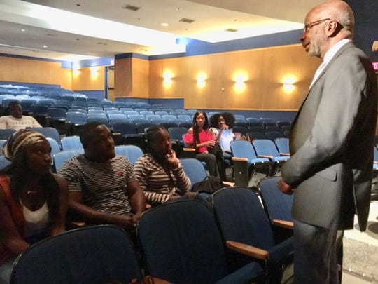 FAMU President Larry Robinson chats with a few Bahamian students inside the Lee Hall auditorium in the wake of Hurricane Dorian.