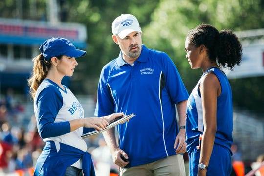 "Coach Harrison (Alex Kendrick), Amy Harrison (Shari Rigby) and Hannah Scott (Aryn Wright-Thompson) talk strategy before a track meet in ""Overcomer. """
