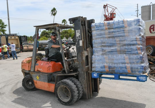 At McCulley Marine Services,1201 North 2nd Street in Fort Pierce, on Thursday, Sept. 5, 2019, volunteers from several companies are collecting relief supplies to be taken by barge on Friday to the Bahamas to help victims of Hurricane Dorian.