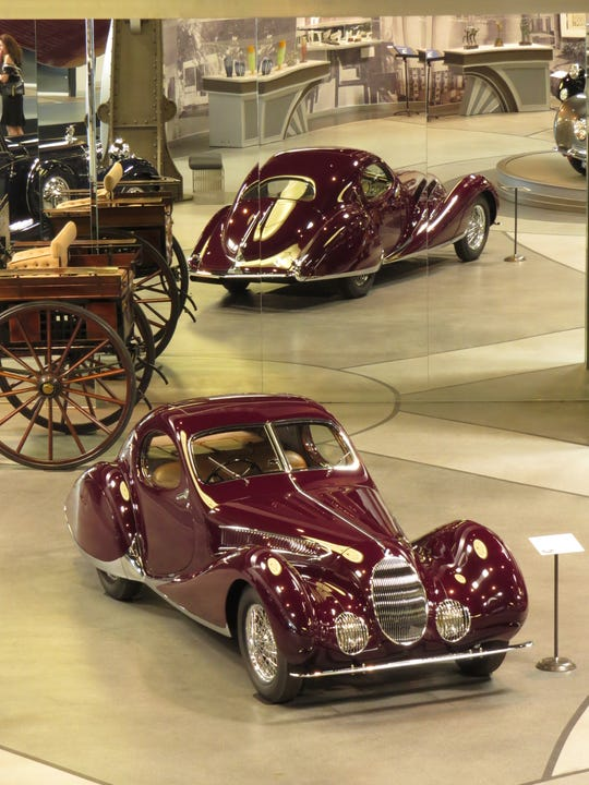 "A 1937 Talbot-Lago Type 150-C-S ""Teardrop"" is seen reflected at the Mullin Automotive Museum in Oxnard. The rare car inspired the bottling of a 2016 syrah from Mullin Estate Wines in Umbria, Italy."