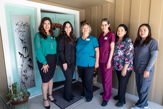 "Sabrina Jimenez, Executive Director of Visalia's Ruth Wood Open Arms Hospice House, left, and staff members Amanda MacDonald, Brenda Cohea, Romelia DeLaCruz, Liz Llamas and Charidel Estrada. It is one of only three such ""social hospice"" homes in California."
