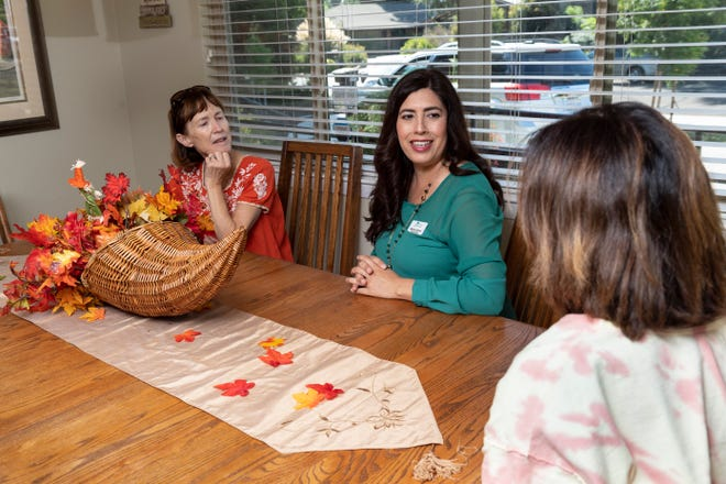 """Sabrina Jimenez, Executive Director of Visalia's Ruth Wood Open Arms Hospice House, center, chats with Pamela Akin, right, and Linda Barlogio. It is one of only three such """"social hospice"""" homes in California."""