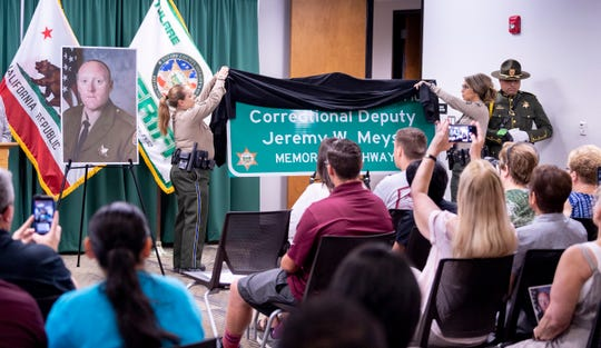 Tulare County Sheriff deputies unveil a highway sign honoring Deputy Jeremy Meyst to family and friends Thursday, September 5, 2019. Meyst was killed in December of 2013 in a collision while transporting inmates on Ben Maddox Way south of Highway 198.
