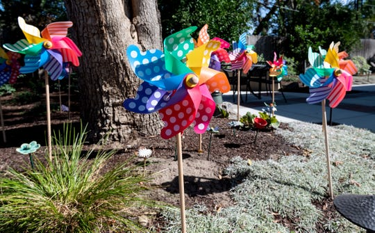 """Pinwheels in the backyard represent past residents at Visalia's Ruth Wood Open Arms Hospice House. It is one of only three such """"social hospice"""" homes in California."""