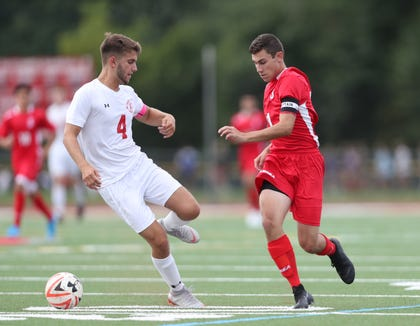 Somers' Drew Lasher (21) works the ball against Tappan Zee's CJ Florencia (4) during their 4-1 win in boys soccer at Tappan Zee High School in Orangeburg on Thursday, September 5, 2019.