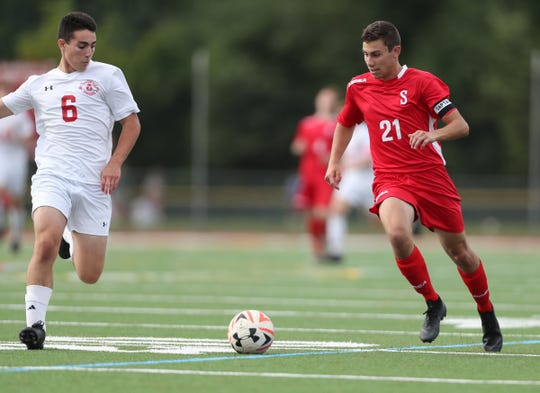 Somers' Drew Lasher (21) works the ball against Tappan Zee's Adam Cooperman (6) during their 4-1 win in boys soccer at Tappan Zee High School in Orangeburg on Thursday, September 5, 2019.