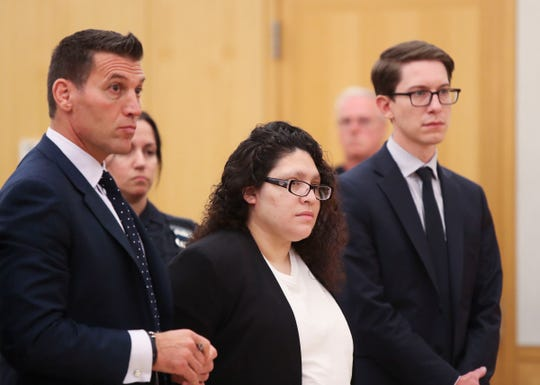 Cynthia Arce, center, pleads guilty in  Westchester County Court in White Plains on Thursday, September 5, 2019.