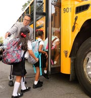 """Thursday Sept. 5, 2019: Dr. Edwin M. Quezada, Superintendent of the Schools, ushers kindergarteners heading to Montessori School 27 onto the bus before he hops on himself for the ride on the first day of school. The Yonkers Public Schools, New York's 4th largest school district, is home to 39 schools with approximately 27,000 students from pre-kindergarten to 12th-grade and 3,500 employees. They transport about 12,000 younger students on yellow buses. """"Being inside the bus with my students was perhaps more rewarding for me than for them. To see their excitement, how happy they were, makes it great for me,"""" said Dr. Quezada."""
