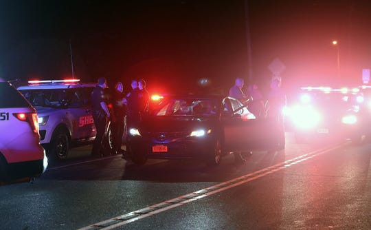 New York State Police and Putnam County Sheriffs look over the 2019 Toyota at the end of the chase on Route 22 and Old Milltown Road in the town of Southeast early this morning Sept. 5, 2019. The car was reported stolen earlier in the Mamaroneck. State police chased the vehicle up I-684 and were joined by Putnam Sheriffs before stopping the vehicle and taking the driver into custody.
