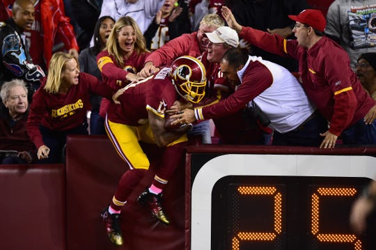 DeSean Jackson, then of Washington, celebrates with fans following his second quarter touchdown against the Seattle Seahawks at FedExField on October 6, 2014 in Landover, Maryland.