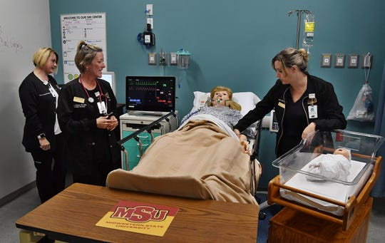 Midwestern State University Simulation Center Director Melody Chandler, RN talks about the capabilities of the high-tech mannequins in the nursing education department of the new Centennial Hall. Darcy Lemmond, RN, left, and Mary Eich, RN help demonstrate.