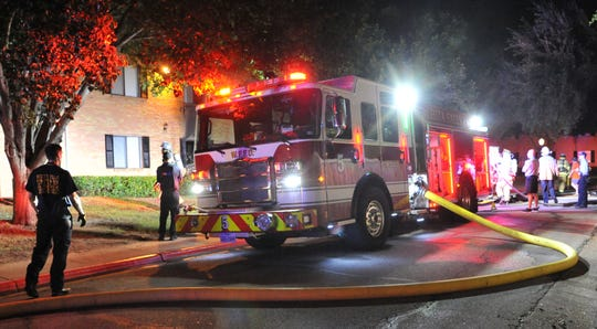 Wichita Falls firefighters work to control a two-alarm apartment fire at a complex located in the 2100 block of Virginia Drive Wednesday night.