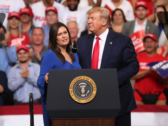 Sarah Sanders and President Donald Trump at a political rally in Orlando in June.