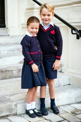 Princess Charlotte and Prince George pose at Kensington Palace shortly before they left with their parents for Charlotte's first day of school at Thomas's Battersea in London, Sept. 5, 2019.