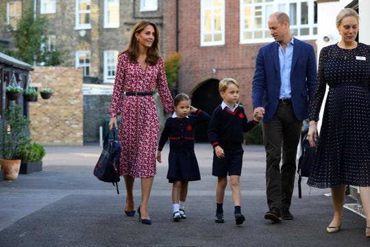 Princess Charlotte  with her parents, Prince William and Duchess Kate of Cambridge, and brother, Prince George, arrive at school, Thomas's Battersea, in London on Sept. 5, 2019.