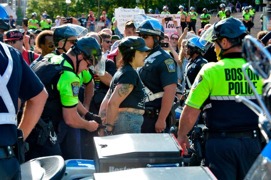 """Boston Police officers arrest an anti-parade demonstrator during the """"Straight Pride"""" parade in Boston, on August 31, 2019. - """"Straight Pride"""" advocates who support President Donald Trump and counter-demonstrators who consider them homophobic extremists staged dueling rallies in Boston on Saturday. (Photo by Joseph PREZIOSO / AFP)JOSEPH PREZIOSO/AFP/Getty Images ORG XMIT: Conservat ORIG FILE ID: AFP_1JX2GF"""