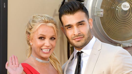 Britney Spears dyes her trademark blond hair brunette – and her boyfriend loves it