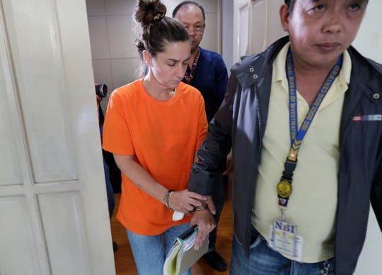 American Jennifer Erin Talbot from Ohio is escorted after a press conference by the National Bureau of Investigation (NBI) in Manila, Philippines on Thursday, Sept. 5, 2019.