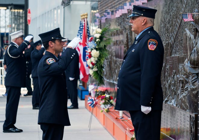 FDNY firefighters, perform the changing of the guard at the FDNY Memorial Wall near the World Trade Center on Sunday, Sept. 11, 2016, on the 15th anniversary of the attacks on the World Trade Center in New York.