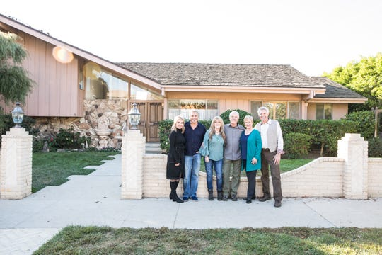 'The Brady Bunch' stars Maureen McCormick, Christopher Knight, Susan Olsen, Mike Lookinland, Eve Plumb and Barry Williams stand in front of the home featured in exterior shots of the Brady residence before its transformation in HGTV's 'A Very Brady Renovation.'