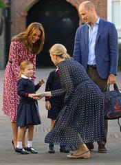 Princess Charlotte shakes hands with Helen Haslem, head of the lower school at Thomas's Battersea in London.
